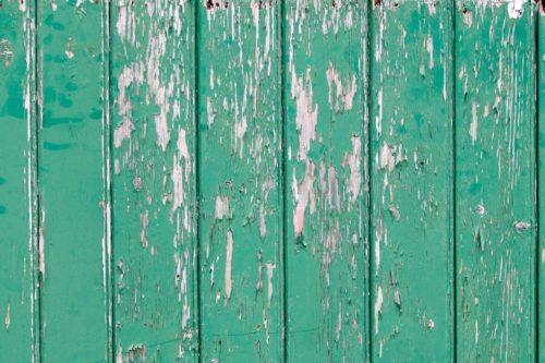 Peeling paint on green wall.